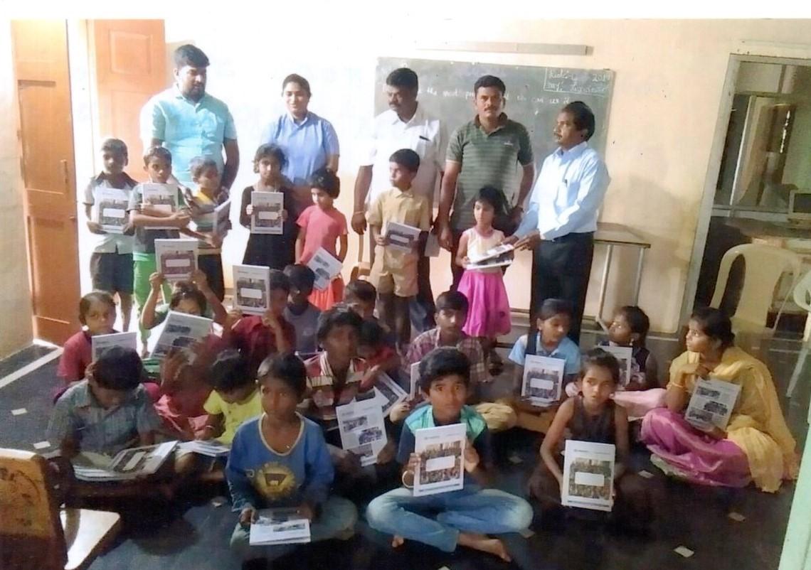 /media/ashrayadhama/1NGO-00060-Ashryadhama-Activity-Books_Distribution.jpg